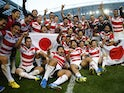 Japan players celebrate beating South Africa at the 2015 Rugby World Cup