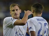 Marc Albrighton celebrates with Riyad Mahrez after scoring in Leicester City's Champions League win at Club Brugge in September 2016