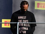 "Lewis Hamilton wears a top reading ""arrest the cops who killed Breonna Taylor"" during the Tuscan Grand Prix in September 2020"