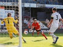 Luton Town's Jordan Clark scores against Derby County on September 19, 2020