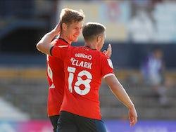 Luton Town duo Jordan Clark and James Collins celebrate on September 5, 2020
