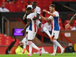 Crystal Palace winger Wilfried Zaha celebrates with teammates after scoring against Manchester United on September 19, 2020