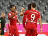 Serge Gnabry celebrates scoring for Bayern Munich against Schalke with Robert Lewandowski on September 18, 2020