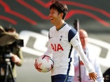 Son Heung-min collects the match ball after scoring four times in Tottenham Hotspur's win over Southampton on September 20, 2020