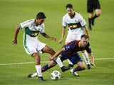 Barcelona's Miralem Pjanic in action with Elche's Cesar during a pre-season friendly on September 19, 2020