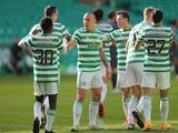 Celtic players celebrate scoring against Hibernian on September 27, 2020