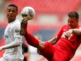 Leyton Orient defender Josh Coulson in action with AFC Fylde's Alex Reid on May 19, 2019