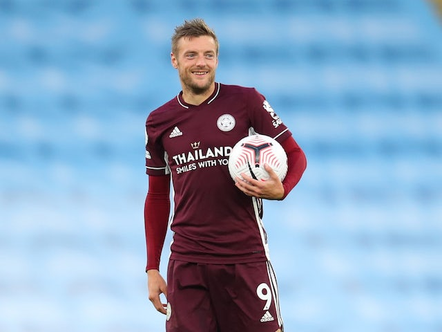 Leicester City's Jamie Vardy claims the match ball after his hat-trick against Manchester City on September 27, 2020