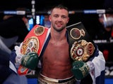 Josh Taylor poses with his belts after winning the fight against Thailand's Apinun Khongsong on September 26, 2020