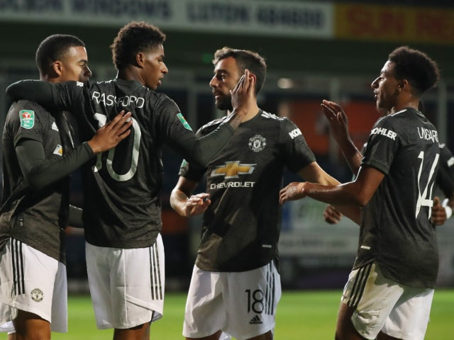 Marcus Rashford celebrates scoring with Manchester United teammates against Luton Town on September 22, 2020