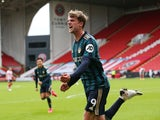 Leeds United striker Patrick Bamford celebrates scoring against Sheffield United on September 27, 2020