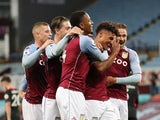 Aston Villa striker Ollie Watkins celebrates with teammates after completing his hat-trick against Liverpool on October 4, 2020