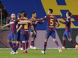Barcelona players celebrate scoring against Sevilla on October 5, 2020