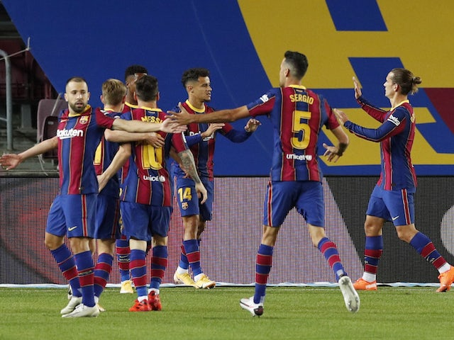 Barcelona players celebrate scoring against Sevilla on October 5, 2020