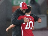 Liverpool manager Jurgen Klopp gives Diogo Jota a hug after his goal against Arsenal on September 28, 2020