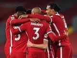Liverpool players celebrate scoring against Arsenal on September 28, 2020