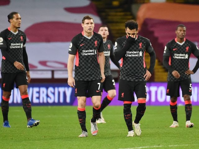 Liverpool players look dejected after conceding their seventh goal against Aston Villa on October 4, 2020