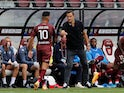 Metz manager Vincent Hognon pictured with Farid Bouyala in August 2020