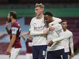 Manchester City's Raheem Sterling celebrates with Cole Palmer in the EFL Cup on September 30, 2020