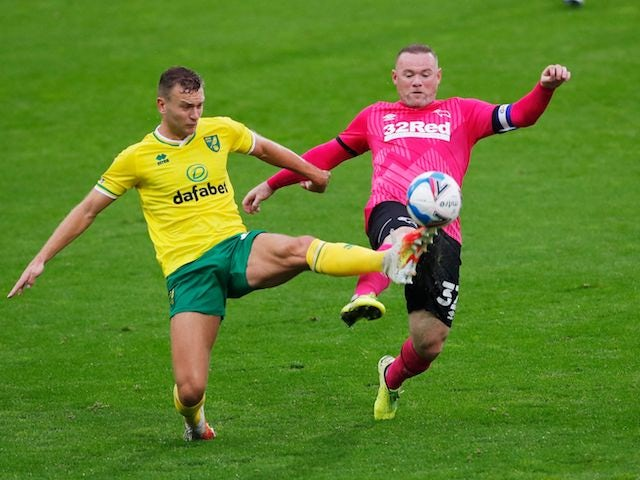 Derby County's Wayne Rooney in action with Norwich City's Ben Gibson in the Championship on October 3, 2020