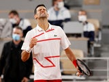 Novak Djokovic celebrates winning in the first round at the French Open on September 29, 2020