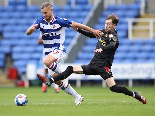 Reading's George Puscas in action with Watford's James Garner in the Championship on October 3, 2020