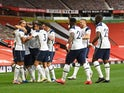 Tottenham Hotspur players celebrate scoring against Manchester United on October 4, 2020