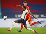 England's Dominic Calvert-Lewin in action with Wales' Chris Mepham in an international friendly on October 8, 2020