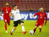 Germany's Nico Schulz in action with Turkey's Efecan Karaca in an international friendly on October 7, 2020