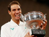 Rafael Nadal celebrates with the French Open trophy after beating Novak Djokovic on October 11, 2020