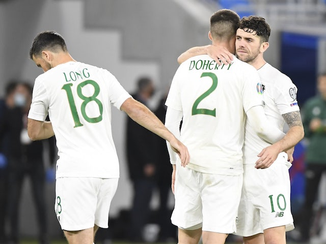 Republic of Ireland's Matthew Doherty is consoled by Robbie Brady and Shane Long following the Euro 2020 qualification playoff defeat to Slovakia on October 8, 2020