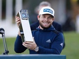 Tyrrell Hatton celebrates winning the BMW PGA Championship on October 11, 2020