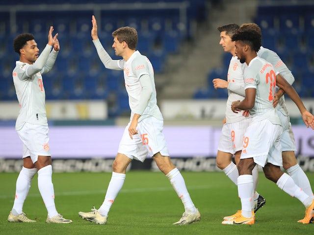 Bayern Munich's Thomas Muller celebrates scoring with teammates against Arminia Bielefeld on October 17, 2020