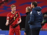 Belgium's Kevin De Bruyne talks to manager Roberto Martinez after coming off injured against England in October 2020