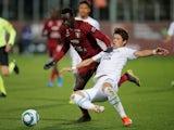 Metz forward Ibrahima Niane in action with Marseille's Hiroki Sakai on December 14, 2019