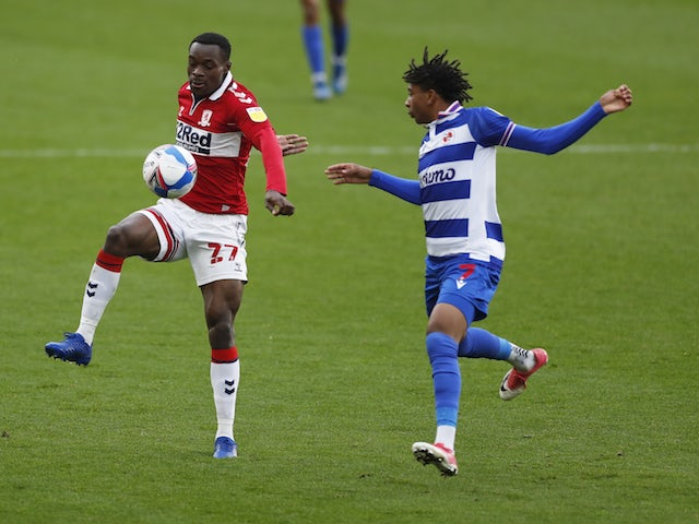 Middlesbrough's Marc Bola in action with Reading's Michael Olise in the Championship on October 17, 2020