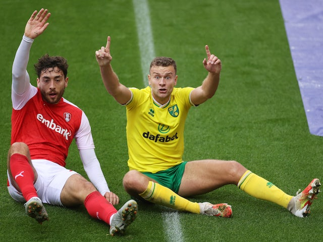 Rotherham United's Matt Crooks and Norwich City's Ben Gibson in action in the Championship on October 17, 2020