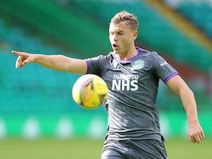 Ryan Porteous heads home as Hibernian beat 10-man St Mirren