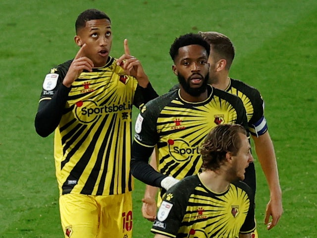 Watford's Joao Pedro celebrates with teammates after scoring against Derby County on October 16, 2020