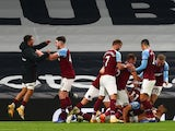 West Ham United celebrate Manuel Lanzini's equalizer against Tottenham Hotspur in the Premier League on October 18, 2020