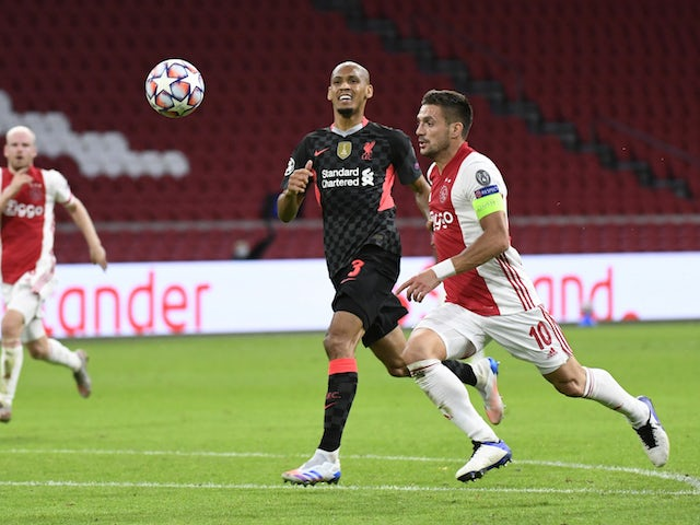 Ajax's Dusan Tadic in action with Liverpool's Fabinho in the Champions League on October 22, 2020