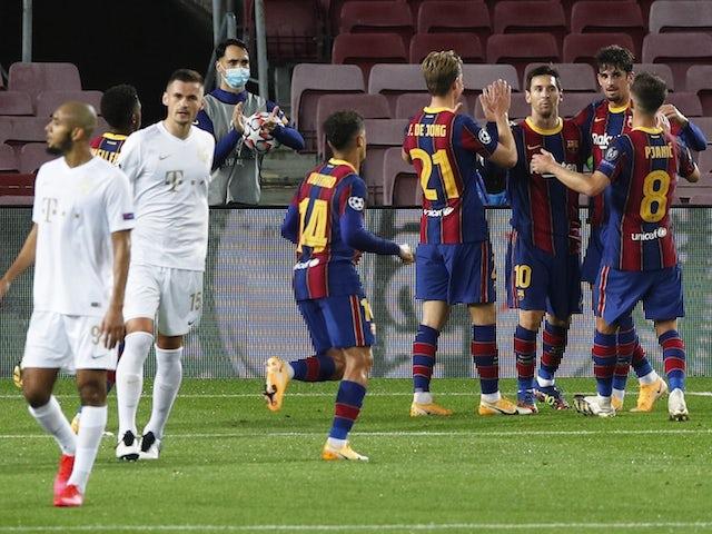 Barcelona's Lionel Messi celebrates with teammates after scoring against Ferencvaros on October 20, 2020