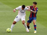 Real Madrid's Casemiro in action with Barcelona's Philippe Coutinho in La Liga on October 24, 2020