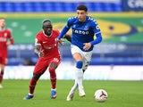Ben Godfrey in action for Everton with Liverpool's Sadio Mane on October 17, 2020