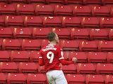 Barnsley's Cauley Woodrow celebrates scoring in October 2020