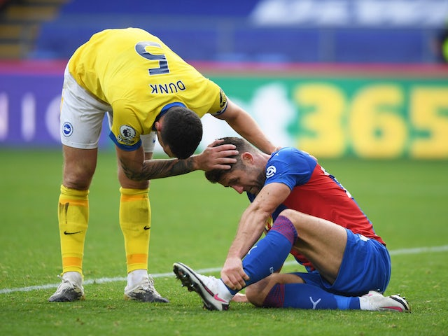Crystal Palace defender Gary Cahill is hurt after a challenge by Brighton's Lewis Dunk in October 2020