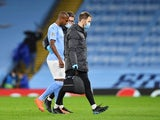 Manchester City midfielder Fernandinho walks off the pitch after picking up an injury against Porto on October 21, 2020