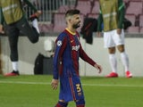 Barcelona defender Gerard Pique walks off after being shown a red card against Ferencvaros on October 20, 2020