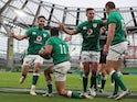 Ireland's Hugo Keenan celebrates scoring with his teammates against Italy on October 24, 2020