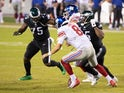 New York Giants's Daniel Jones in action with Philadelphia Eagles's Vinny Curry and Brandon Graham in October 2020